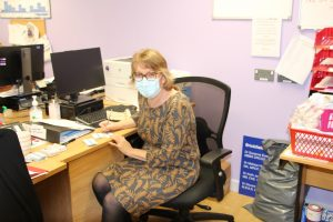 Lead GP and Clinical Director for Dengie, Dr McGeachy preparing vaccine cards